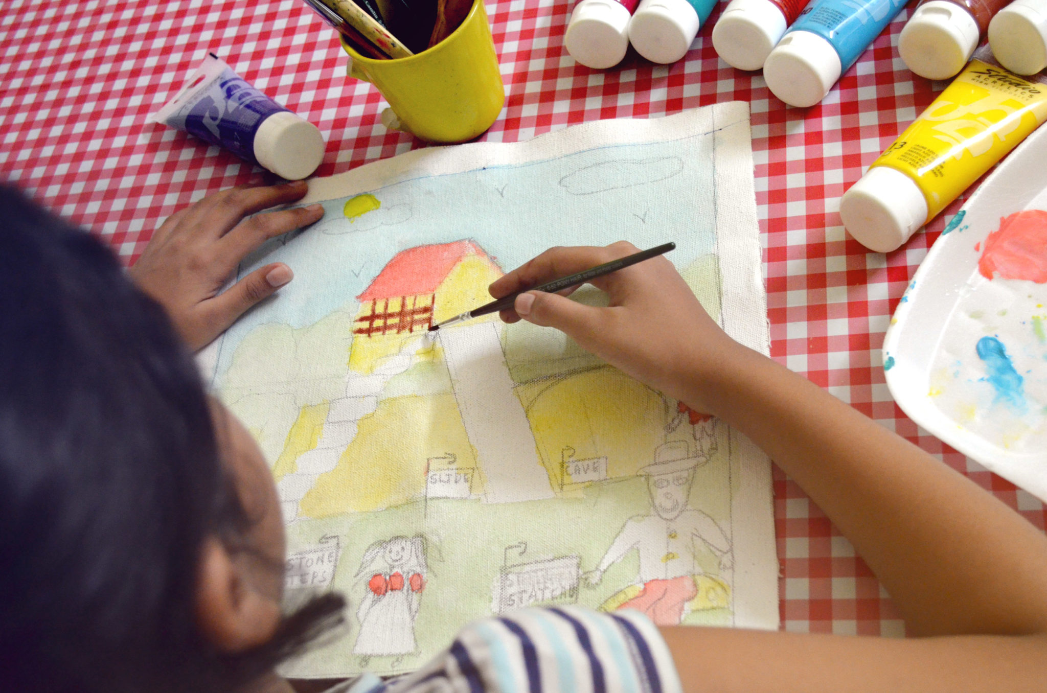 handcrafting together by drawing and painting