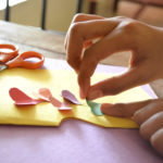 handcrafting together with paper, scissors, glue